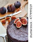 Small photo of ?hocolate ?ake with fresh figs on old wooden background, selective focus