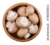 Small photo of Brown champignons in a wooden bowl on white background. Agaricus bisporus, edible mushrooms, also called cremini, brown cap or chestnut mushrooms. Isolated macro food photo close up from above.