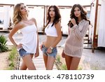fashion outdoor photo of gorgeous sexy women in casual clothes, having fun on summer beach