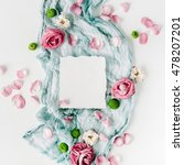 Stock photo clean paper blank with red roses pink petals and blue textile on white background flat lay top 478207201