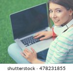 young woman with laptop sitting ... | Shutterstock . vector #478231855