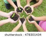 hands holding sapling in soil... | Shutterstock . vector #478301434