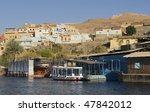 """The old town of """"Aswan"""" at the river """"Nil"""" in Egypt - stock photo"""