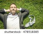 happy man lying in the grass... | Shutterstock . vector #478518385