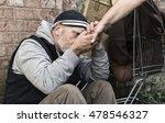 Homeless Man Taking An...