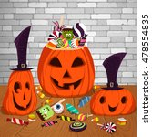 three halloween pumpkins on the ... | Shutterstock .eps vector #478554835