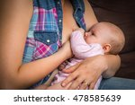 happy mother breast feeding... | Shutterstock . vector #478585639