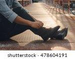 man's hands tying shoes  brown... | Shutterstock . vector #478604191