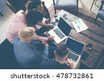 Small photo of Group Young Coworkers Making Great Business Decisions.Creative Team Discussion Corporate Work Concept Modern Office.New Startup Marketing Idea Presentation.Woman Touching Digital Laptop.Top View