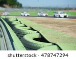 Green Tire Barrier Close Up Of...