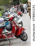 Small photo of STOCKHOLM, SWEDEN - SEPTEMBER 03, 2016: People admiring the parked retro vespa scooters before the start of the Mods vs Rockers event at the Saint Eriks bridge, Stockholm, Sweden, September 03, 2016
