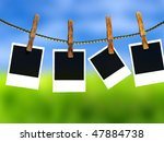 Stock photo photos on a clothes line against a green field 47884738