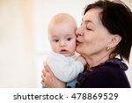grandmother is kissing her baby ... | Shutterstock . vector #478869529