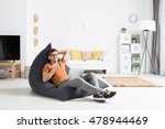 young man sitting on a modern... | Shutterstock . vector #478944469