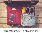open suitcase with casual... | Shutterstock . vector #478954414