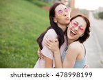 two cheerful young women... | Shutterstock . vector #478998199