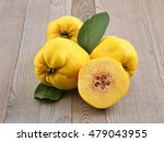 Quince On Wood Background....