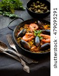 paella in black pan with rice ... | Shutterstock . vector #479095291