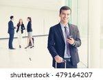 smiling  businesman using...   Shutterstock . vector #479164207