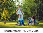 young happy family of four on... | Shutterstock . vector #479217985