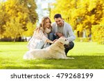 Stock photo family pet animal and people concept happy couple with labrador retriever dog walking in autumn 479268199