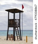 Tower Of Lifeguard With Red Flag