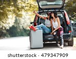two young women with suitcases... | Shutterstock . vector #479347909