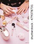 woman putting nail polish | Shutterstock . vector #479378731