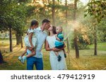 happy young family of four... | Shutterstock . vector #479412919