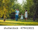 happy young family of four... | Shutterstock . vector #479413021