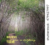 Small photo of Beautiful enchanted forest with trail under bending branches. Mystical forest Inspirational quote: Believe and you're halfway there. Instagram effects.