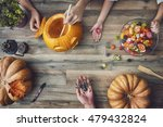 Stock photo happy halloween a mother father and their daughter carving pumpkin on the table in the home 479432824