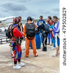 Small photo of Seville, Spain - May 7, 2016: Group of skydivers prepaire to skydive. Skydiving center at La Juliana Aerodrome offer world-class coaches for progression courses or team training of any discipline.