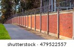 Brick Wall With Barbed Wire Top ...