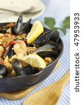 spanish meal paella on a blue... | Shutterstock . vector #47953933