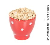 red cup with oats flakes pile...   Shutterstock . vector #479544091
