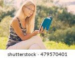 young  beautiful woman resting... | Shutterstock . vector #479570401