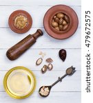 argan seeds and oil on white... | Shutterstock . vector #479672575