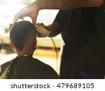 little boy getting hair cut by... | Shutterstock . vector #479689105