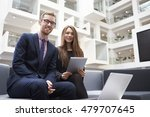 two businesspeople using laptop ... | Shutterstock . vector #479707645