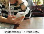 the user of the phone in a cafe | Shutterstock . vector #479858257