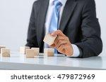 businessman making tower   Shutterstock . vector #479872969