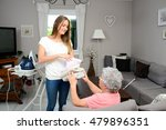 cheerful young girl ironing and ... | Shutterstock . vector #479896351