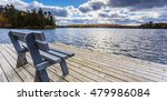 bench view by water edge | Shutterstock . vector #479986084