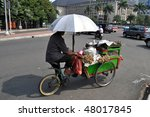 Rickshaw driver, Jakarta, Indonesia - stock photo