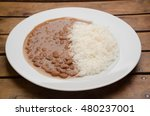 A Plate Of Rice And Beans