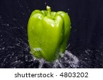 Isolated Green Pepper On Black...