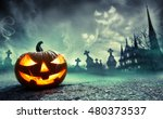 Stock photo pumpkin burning in a graveyard with ghost nightmare 480373537