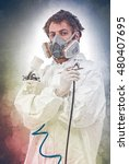 Small photo of Worker with airbrush gun, on a colored background