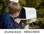 school boy opening a post box... | Shutterstock . vector #480614845